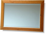 Wide flat antiqued pine frame, bevelled mirror. Available in many sizes.