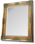 Very Large Gold Rococo styled framed mirror with intricate detailing and scrolling.  This photograph cannot capture the grandeur of this very large mirror.Combines massive proportions with an elegance rarely available in modern home furnishings.
