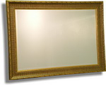 Wooden frame decorated mainly in gold with black ribbing. Bevelled mirror. available in many sizes