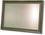 Modern Wooden frame decorated mainly silver with black ribbing. Bevelled mirror